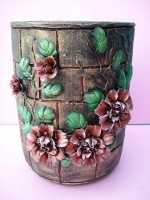 Brown Ceramic Vase With Protruding Colored Leaves & Flowers