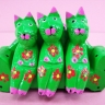 Family Of 3 Green Cats Sitting On A Green Sofa, Carved, Colored